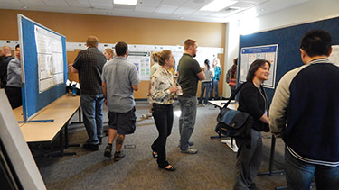 More symposium displays and attendees