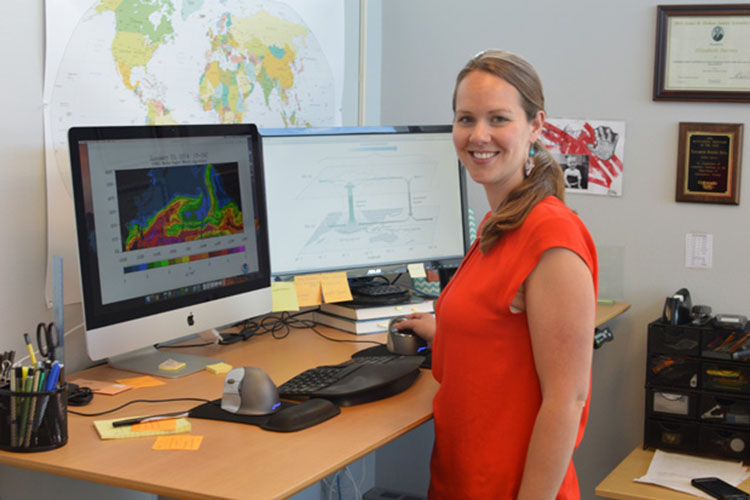 Assistant Professor of Atmospheric Science Libby Barnes at her desk