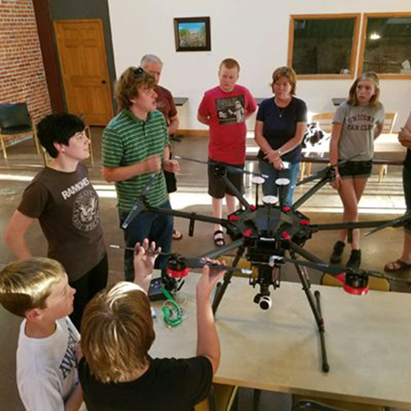 Graduate student Sean Freeman discusses research using drones with teens during Teen Science Cafe