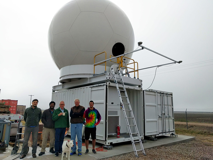 Members of the SEA-POL team with the radar, right before disassembly and shipment to San Diego for its voyage to sea. From left: engineer Francesc Junyent, engineer Jim George, CSU-CHILL facility manager Pat Kennedy, Professor of Atmospheric Science Steve Rutledge, graduate student Alex Morin, and Rutledge's dog, Saphira.