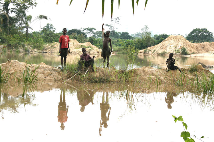 Boys fishing in Ghana