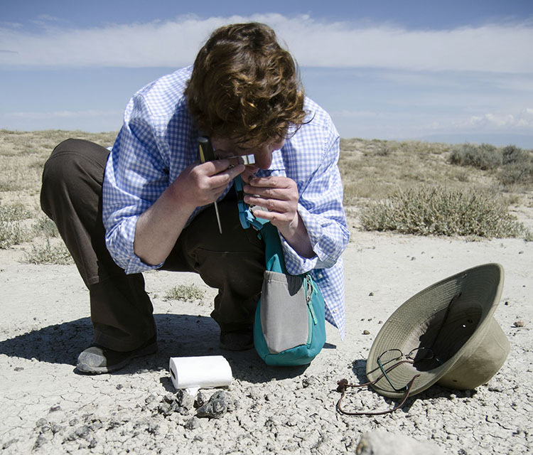 Paleontologist Kim Nichols works in the field
