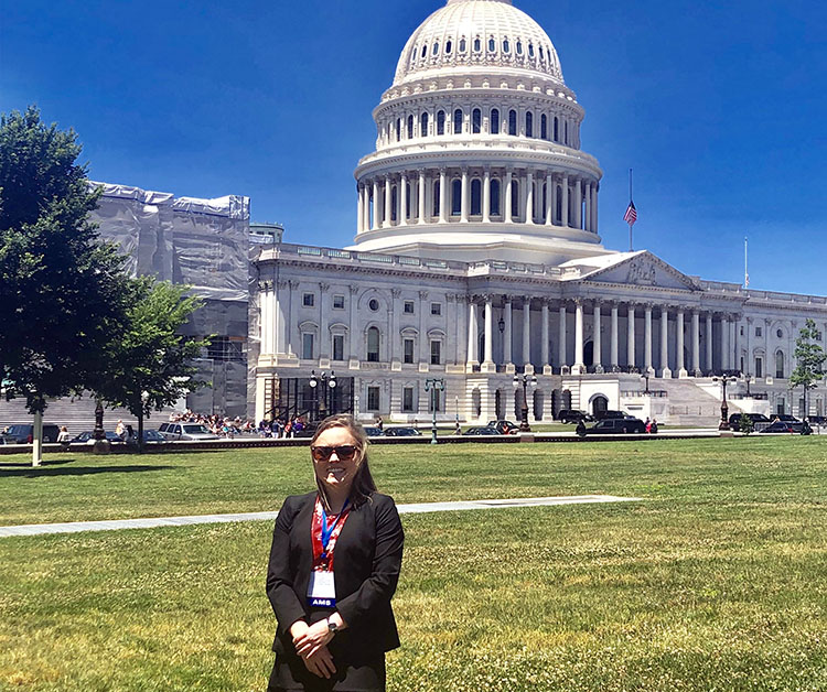 Kate O'Dell in front of the Capitol Building