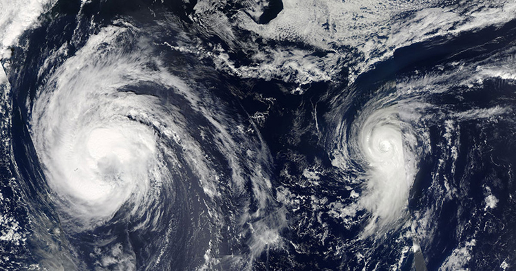 satellite image of two hurricanes